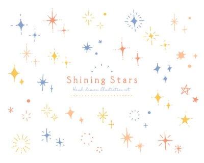 Fototapeta 手描きのキラキラや星のイラストセット アイコン 光 輝き シンプル 飾り 装飾 スター 手書き