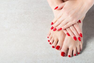 Fototapeta Young lady is showing her red manicure nails