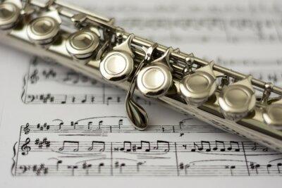 Fototapeta Zblízka na flétnu flétnu noty pozadí