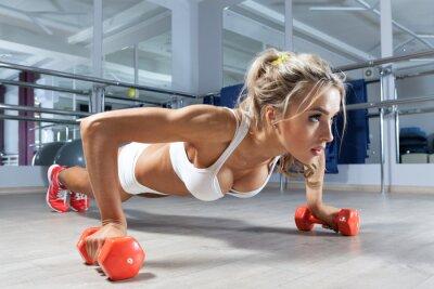 Fototapeta Žena push-up na podlaze