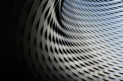 Nálepka abstraktní kovové konstrukce s opakujícím se vzorem pozadí