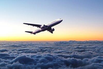 Nálepka Airplane in the sky at sunrise