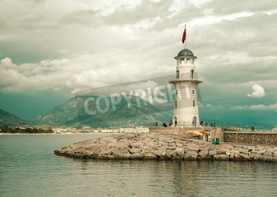 Nálepka Beautiful nature landscape with mountains range, cloudy sky and lighthouse in port Alanya, Turkey