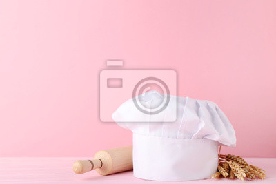 Nálepka Chef hat with rolling pin and wheat ears on pink background