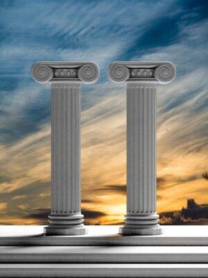 Nálepka Dvě starověké sloupy s západ slunce pozadí oblohy.