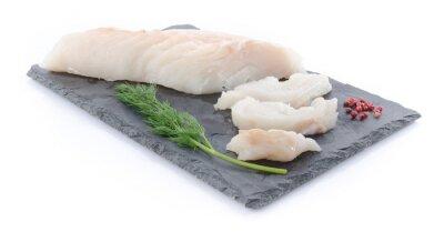 Nálepka Fresh raw cod fillet on a slate plate