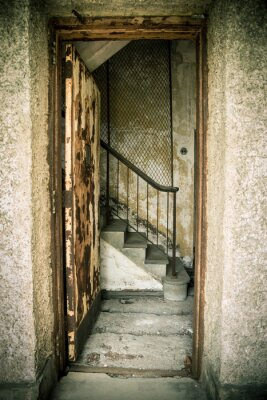 Nálepka Grungy abandoned home with door and stairs
