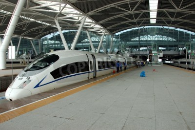 Nálepka GUANGZHOU, CHINA - SEPTEMBER 29: China invests in fast and modern railway, trains with speed over 340 km/h. Train to Wuhan on September 29, 2010 waits in newly build Guangzhou South station.