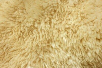 Hnědá chlupatá přírodní ovčí kožešinová textura na pozadí