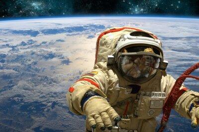 Nálepka Kosmonaut vznáší v prostoru. - Prvky tohoto obrázku zařízeném NASA.