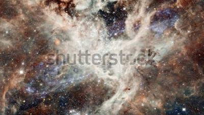 Nálepka Mlhovina noční hvězdná obloha v barvách. Vícebarevný vesmír. Hluboký vesmír mnoho světelných let daleko od planety Země. Prvky tohoto obrázku poskytnuté NASA