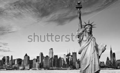 Nálepka photo statue of liberty new york city black and white hi contrast. nyc new york city skyline over Manhattan cityscape midtown. statue of liberty over hudson river in new york city.