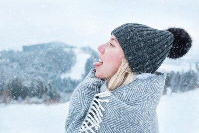 Nálepka Portrait Happy woman traveler on the snowy of mountain look on t