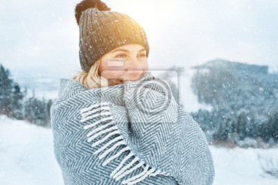 Nálepka Portrait Happy woman traveler on the snowy of mountain look on t