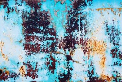 Nálepka rezavé kovové s prasklým modrou barvou. barevné pozadí rezavé železo povrchu s jasně modrou barvu peeling a praskání textury