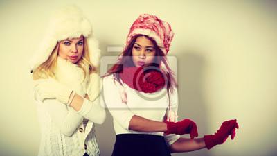 Nálepka Two girls in warm winter clothing portrait.