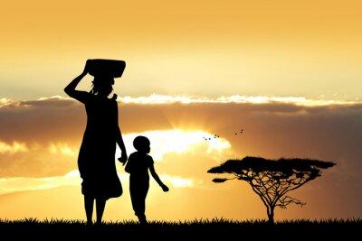 Obraz Africká žena a syn při západu slunce