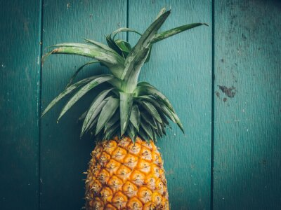 Obraz Ananas na texturu dřeva