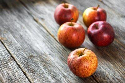 Obraz Apples on wooden background