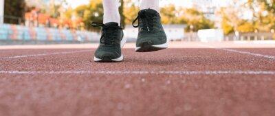 Obraz athlete's feet on a running track