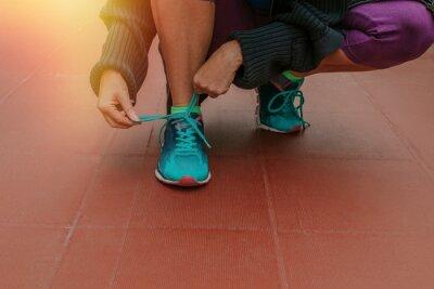 Obraz athlete's foot tying the shoelaces