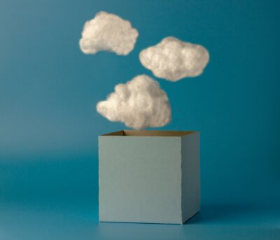 Obraz Box and clouds on blue background. Creative thinking concept. Think outside the box.