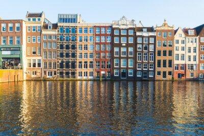 Obraz Budovy podél Damrak během dne v Amsterdamu
