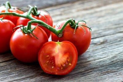 Obraz Čerstvá rajčata na dřevo pozadí
