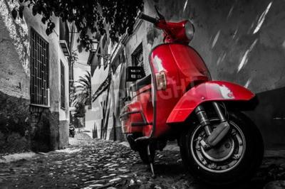 Obraz Červená skútr Vespa zaparkovaný na dlážděné ulici
