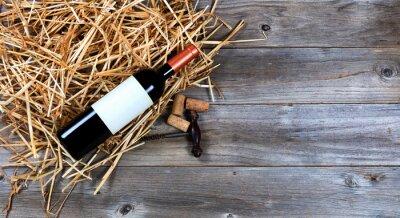 Obraz Červené víno láhev s archivní víno vývrtka na slámě