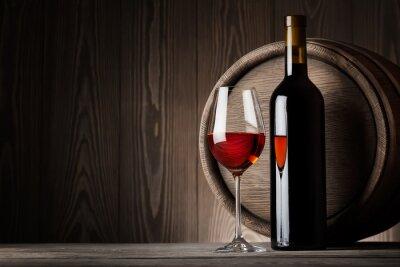Obraz Červené víno ve skle s lahví