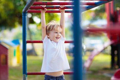 Obraz Child on playground. Kids play outdoor.