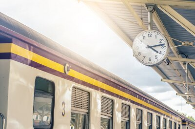 Obraz Classic urban analog clock in train station terminal. Concept photo of time, appointment, deadline, meeting, business, travel and schedule..