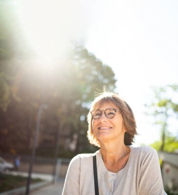 Obraz Close up smiling older woman with eyeglasses outside