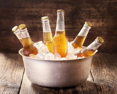 Obraz cold bottles of beer in bucket with ice
