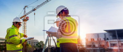 Obraz Construction engineers discussion with architects at construction site or building site of highrise building with Surveying for making contour plans is a graphical representation of the lay in land.