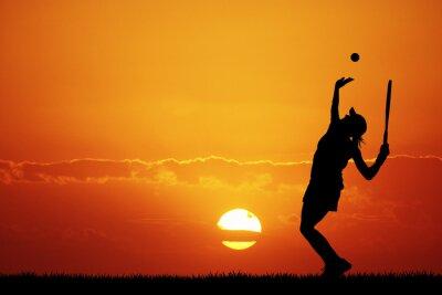 Obraz dívka hrát tenis při západu slunce