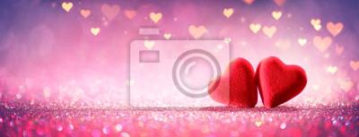Obraz Dvě srdce na růžové třpytky v lesklém pozadí - den svatého Valentýna koncept