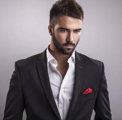Obraz Elegantní mladý pohledný muž. Studio módní portrét.