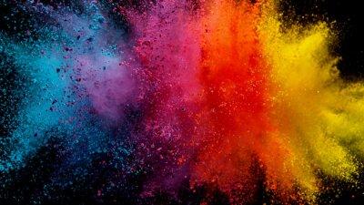 Obraz Explosion of colored powder on black background