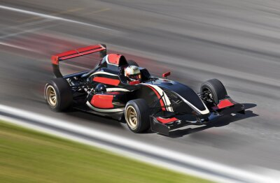 Obraz F1 race car racing on a track with motion blur
