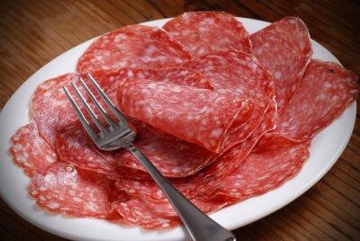 Obraz Fette di Salame italiano sul Piatto