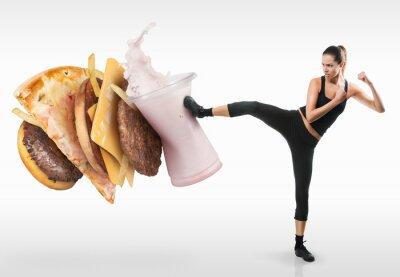 Obraz Fit mladá žena bojuje off fast food