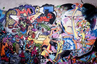 Obraz Fond Mur de graffitis aux couleurs Vives