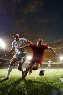 Obraz Fotbalisté v akci na západ stadionu pozadí