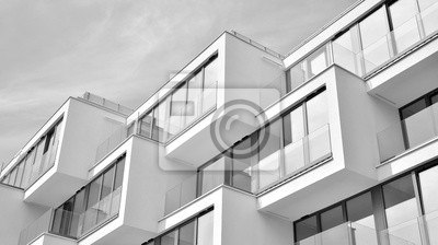 Obraz  Fragment of a facade of a building with windows and balconies. Modern home with many flats. Black and white.