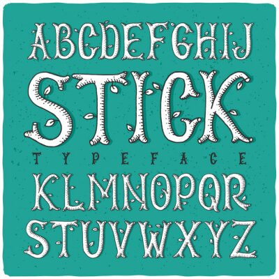 Obraz Grafický typ ruční ze stylizovaných dřevěných tyčí. Bílá na zeleném pozadí.