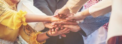 Obraz Group of people diversity multiethnic teamwork collaboration team meeting communication  Unified team concept. Business people hands together diversity multiethnic diverse culture partner team meeting