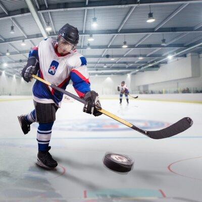 Obraz Hokejista vystřelí puk a útoky