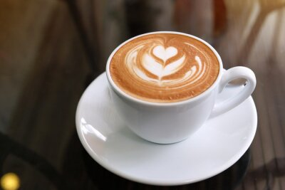 Obraz hot latte coffee put on table in cafe restaurant, drink breakfast in the morning day